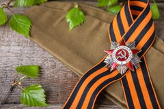 The Soviet order of the Second World war and George ribbon Victory Day 9 May postcard concept. Toned vintage Stock Photo