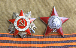 Soviet orders. Red Star and Greate National War and St. George ribbon. Soviet insignia. two orders for paticipation and heroism in Great national War - World War Stock Photos