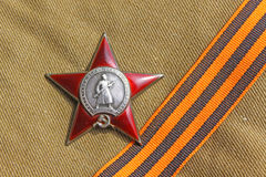 Soviet orders Red Star and the St. George ribbon. Soviet insignia order of Greate National War and the St. George ribbon Royalty Free Stock Image