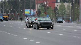 Soviet passenger cars go on parade formation. Russian army, special car transports Battle Tank stock footage