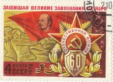 Soviet postage stamp. `Defending the great gains of October`1978 stock photography