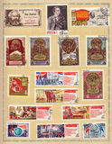 Soviet postage stamps 1970. A collection of Soviet Union postage stamps with seals dedicated to socialist labor and adorned with slogans, 1970s Stock Image