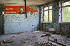 Soviet propaganda mural in Pripyat town. Pripyat, Ukraine - May 9, 2011: Dilapidated soviet propaganda mural in the room of abandoned building in Pripyat town in stock photos