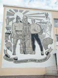Communism: Soviet retro propoganda poster. Communistic Wallpainting of Soviet propoganda for mining Royalty Free Stock Image