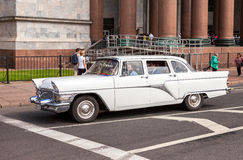 Soviet retro car Chaika GAZ-13 on the city street in summer sunn Stock Images