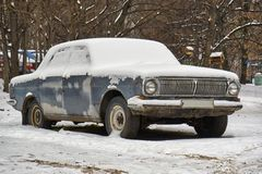 Soviet retro car Volga abandoned on the street Stock Images