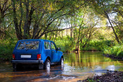 SUV in water Royalty Free Stock Photos