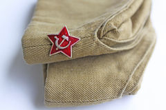 Soviet simvol red star. Soviet insignia Red star and soldier field cap Stock Image