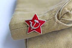 Soviet simvol red star. Soviet insignia Red star and soldier field cap Stock Photography