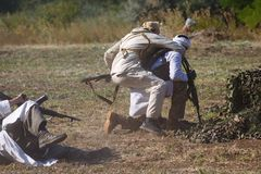 Soviet soldier attacks mojahed from behind. SAMBEK, ROSTOV REGION, RUSSIA, AUGUST 19, 2018: Reconstruction of Afghan war. Soviet soldier attacks mojahed from stock photo