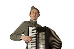 Soviet soldier playing the accordion over white background Royalty Free Stock Photo