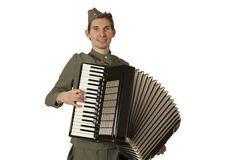 Soviet soldier playing the accordion over white Royalty Free Stock Images