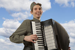 Soviet soldier playing the accordion Stock Images