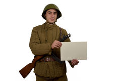 Soviet soldier shows sign Royalty Free Stock Images