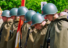 Soviet soldiers in helmets and cloaks Stock Images