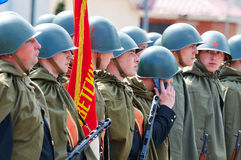 Soviet soldiers in helmets and cloaks Royalty Free Stock Images