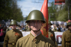 Soviet soldiers. Photo of a young man, dressed in a Soviet soldier in the form of a victory parade on May 9 Royalty Free Stock Photography