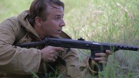 Soviet soldiers take firing position. World war II reconstruction stock footage