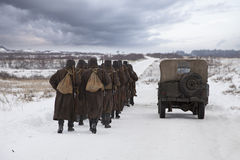 Soviet soldiers in a winter field Stock Photos