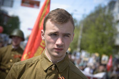 Soviet soldiers. Yoshkar-Ola, Russia - May 9, 2016: Photo of a young man, dressed in a Soviet soldier in the form of a victory parade on May 9 in central city Royalty Free Stock Image