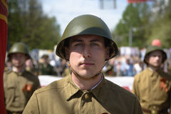 Soviet soldiers. Yoshkar-Ola, Russia - May 9, 2016: Photo of a young man, dressed in a Soviet soldier in the form of a victory parade on May 9 in central city Stock Photography
