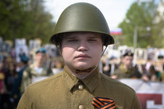 Soviet soldiers. Yoshkar-Ola, Russia - May 9, 2016: Photo of a young man, dressed in a Soviet soldier in the form of a victory parade on May 9 in central city Royalty Free Stock Images