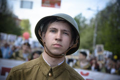 Soviet soldiers. Yoshkar-Ola, Russia - May 9, 2016: Photo of a young man, dressed in a Soviet soldier in the form of a victory parade on May 9 in central city Royalty Free Stock Photo