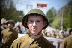 Soviet soldiers. Yoshkar-Ola, Russia - May 9, 2016: Photo of a young man, dressed in a Soviet soldier in the form of a victory parade on May 9 in central city Royalty Free Stock Photography