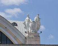 Soviet statue on roof of passenger train station in Kharkiv Stock Photos