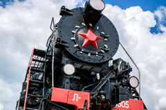 Soviet steam locomotive. The front part of the Soviet steam locomotive with a star Royalty Free Stock Photo