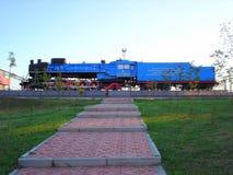 Soviet steam locomotive Novosibirsk. Soviet steam locomotive in Novosibirsk on blue sky. Russia, Siberia Stock Images