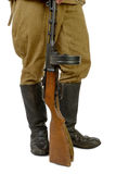 Soviet submachine gun at the foot of a soldier Stock Photo
