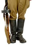 Soviet submachine gun at the foot of a soldier Royalty Free Stock Images