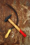 The soviet symbol sickle and hammer. On rusty  background Stock Image