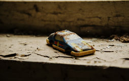 Soviet toys of rusty car in Chernobyl nuclear disaster area. Stock Photography