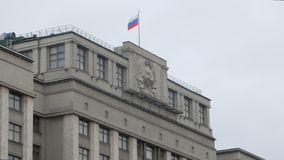 Soviet Union emblem on government buildings in Russia, close-up, contemporary flag on top. Soviet Union emblem on government buildings in Russia, close-up stock video footage