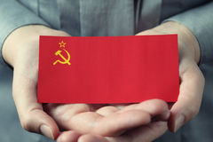 Soviet Union flag in palms Stock Photos