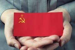 Soviet Union flag in palms Stock Photos