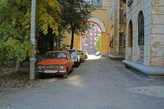 Soviet vehicle Moskvitch-412 and other cars in the yard in Volgograd. Volgograd, Russia - October 11, 2014: Soviet vehicle Moskvitch-412 and other cars in the Stock Photos
