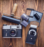 Soviet vintage camera,exposure meter and another trappings of film photography.top view. Royalty Free Stock Photo
