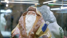 Retro xmas santa claus figurine. Soviet vintage santa claus ded moroz figurine on display in shopping mall. Close up stock video footage