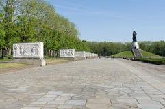 Soviet War Memorial (Treptower Park). Soviet war memorial - statue of the Russian soldier holding a child Stock Photos