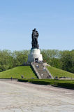 Soviet War Memorial (Treptower Park). Soviet war memorial - statue of the Russian soldier holding a child Royalty Free Stock Images