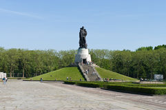 Soviet War Memorial (Treptower Park). Soviet war memorial - statue of the Russian soldier holding a child Royalty Free Stock Photos