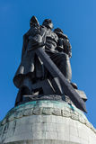 Soviet War Memorial (Treptower Park). Monument - Warrior-Liberator with a sword and holding a little girl in her arms Royalty Free Stock Image