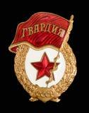 Sovjet militair kenteken. Geïsoleerdl op zwarte Stock Afbeeldingen