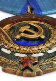 Sovjetisk beställning av det röda banret av arbete på vit bakgrund Arkivfoton