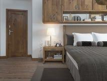 Sovrum i modern stil med en nattduksbord på dörrtypen Arkivfoton