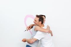 sovrumpar som kramar att renovera Fotografering för Bildbyråer