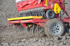 Sow the seed. Farmer drilling seed into pasture paddock, Westland, New Zealand Stock Images